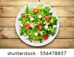 fresh caesar salad on white... | Shutterstock . vector #556478857