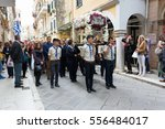 "Small photo of CORFU, GREECE - APRIL 29, 2016: The epitaph processions of Good Friday in Corfu. In Corfu every church is organizing a litany, carrying its ""Epitaphios"" and with the accompaniment of philharmonics."
