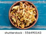 bowl of chanterelles mushrooms...   Shutterstock . vector #556490143