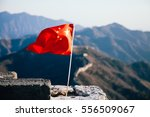 china flag waving over the... | Shutterstock . vector #556509067