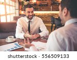 handsome business partners are... | Shutterstock . vector #556509133