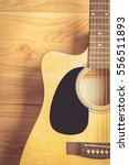 Small photo of Acoustic guitar on wood background , vintage tone