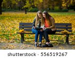 Early Warm Fall. Two Girls Sit...
