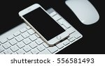 white smartphone and keyboard... | Shutterstock . vector #556581493