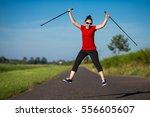 nordic walking   young woman... | Shutterstock . vector #556605607