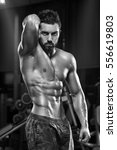 sexy muscular man in gym ... | Shutterstock . vector #556619803