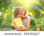 beautiful mother and her little ... | Shutterstock . vector #556702627