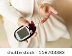 close up of girl hands checking ...   Shutterstock . vector #556703383