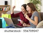 two excited friends buying on... | Shutterstock . vector #556709047