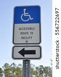 Small photo of People with disabilities accessible route to facility sign