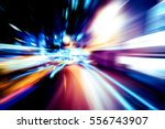 moving traffic light trails at... | Shutterstock . vector #556743907