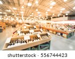 blurred image aisle of bottles... | Shutterstock . vector #556744423