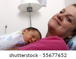 Proud grandmother with baby boy - stock photo