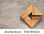 tangram puzzle as arrow in... | Shutterstock . vector #556784323
