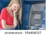 Sad Woman Beside Atm Bank...