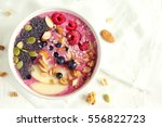 smoothie bowl with fresh... | Shutterstock . vector #556822723