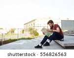 handsome man read the map of... | Shutterstock . vector #556826563