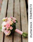 wedding bouquet lies on a bench ... | Shutterstock . vector #556890373