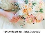 wedding bouquet of the bride ... | Shutterstock . vector #556890487