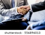 businessman shaking hands to... | Shutterstock . vector #556896013