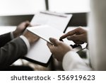 business adviser analyzing... | Shutterstock . vector #556919623