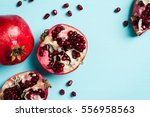Red Ripe Pomegranates On Blue...