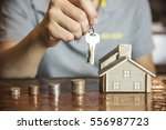 a home model and coin stack ... | Shutterstock . vector #556987723