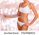 lady with a tape measure on an... | Shutterstock . vector #556988833