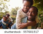 two young adult black couples... | Shutterstock . vector #557001517