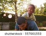 young black boy playing on his... | Shutterstock . vector #557001553