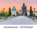 Stock photo prague czech republic charles bridge karluv most and old town tower at sunrise 557010367