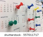 Small photo of Orful thumbtacks on the calendar to show the annual planning.