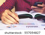 man calculate about cost and... | Shutterstock . vector #557054827
