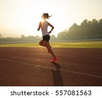 young fitness woman runner... | Shutterstock . vector #557081563