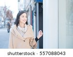young woman walking in the city | Shutterstock . vector #557088043