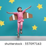 little child girl in an... | Shutterstock . vector #557097163