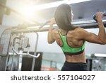 muscular fitness woman doing... | Shutterstock . vector #557104027