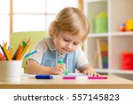 little boy paints in his... | Shutterstock . vector #557145823