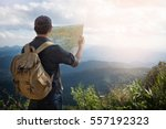 Young Man Traveler With Map...