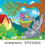 bunny holding easter basket... | Shutterstock .eps vector #557210323