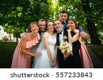 beautiful newlyweds with their... | Shutterstock . vector #557233843