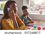 mother talking on phone... | Shutterstock . vector #557268877