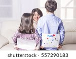 children giving her mother a...   Shutterstock . vector #557290183