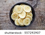 Bowl Of Sliced Banana On Woode...