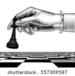 woman's hand with a black king... | Shutterstock .eps vector #557309587