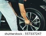 mechanic using a torque wrench... | Shutterstock . vector #557337247