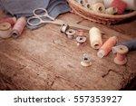 scissors  bobbins with thread... | Shutterstock . vector #557353927