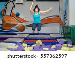 Small photo of Young happy Woman playing in children foam pit ball
