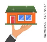hand holding new house  vector... | Shutterstock .eps vector #557372047