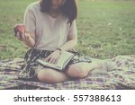 Woman In Straw Hat Eating An...